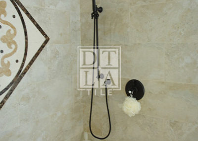 Shower enclosure and new plumbing fixtures of bathroom with porcelain tile in Manhattan Beach