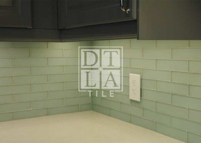 Different view of kitchen backsplash with glass tiles